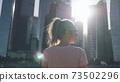 Woman Look At Skyscrapers 73502296