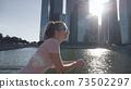 Woman Look At Skyscrapers 73502297