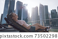 Woman Chilling on the Deck 73502298