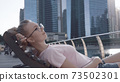 Woman Chilling on the Deck 73502301