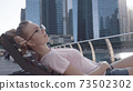 Woman Chilling on the Deck 73502302