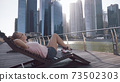 Woman Chilling on the Deck 73502303