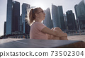 Woman Chilling on the Deck 73502304