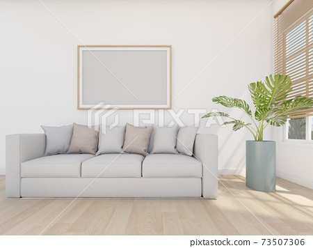 grey sofa in white room with ficture frame 73507306