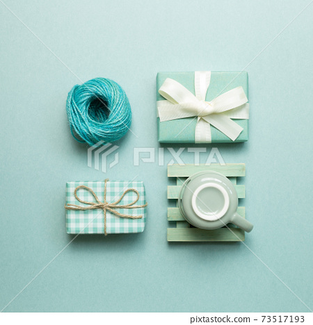 Gift boxes, coffee cup, string roll on mint green background. flat lay, top view, copy space 73517193