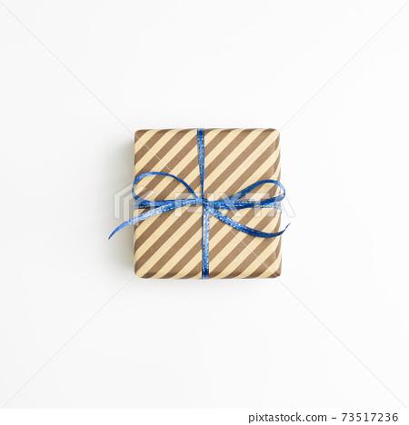 Brown stripe pattern gift box isolated on white background. top view, copy space 73517236