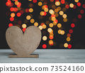 Heart shape on white wood table with colourful bokeh backgrounds 73524160