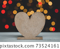 Heart shape on white wood table with colourful bokeh backgrounds 73524161