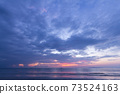 Beautiful tropical purple beach sunset with colourful sea sky 73524163