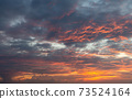 Sunset dramatic orange clouds sky background 73524164