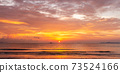 Beautiful tropical golden beach sunset with colourful sea sky 73524166