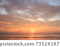 Beautiful tropical golden beach sunset with colourful sea sky 73524167