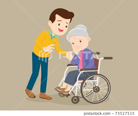 man soothes a grieving grandmother sitting on a wheelchair 73527515