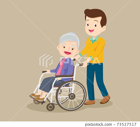 caring man and grandmother sitting on wheelchair 73527517
