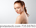 Shirtless Woman With Red Hair And Ponytail Posing, White Background 73530763