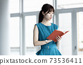 A young lady with a notebook 73536411