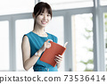 A young lady with a notebook 73536414