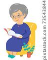 Elderly woman reading 73543844