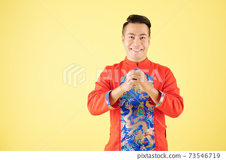Vietnamese man making greeting gesture 73546719