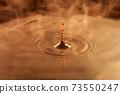 Ripples of water drops brown coffee 73550247