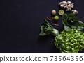 Top view of vegetables and on black background with copy space for insert text. Healthy food concept. 73564356