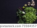 Top view of vegetables and on black background with copy space for insert text. Healthy food concept. 73564357