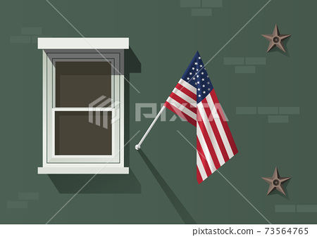 The USA flag hanging on the facade of an old building with a white window 73564765