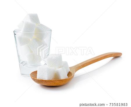 Sugar cubes isolated on white background. 73581983