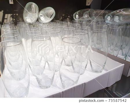 glass vases on shelf in store. Interior decor store 73587542