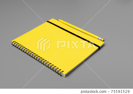 Yellow notepad with yellow pencil on gray background 73591529