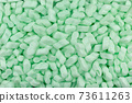 Green Polystyrene Foam Peanuts Packaging Filler Cushioning Material Texture Background 73611263