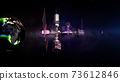 Space station in space between the Moon and Earth. 73612846
