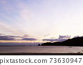 First sunrise, sea, sandy beach 73630947