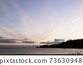 First sunrise, sea, sandy beach 73630948