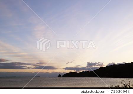 First sunrise, sea, sandy beach 73630948