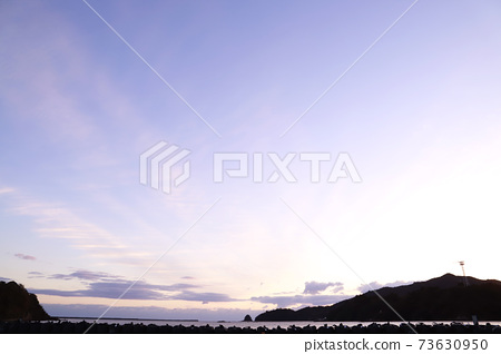 First sunrise, sea, sandy beach 73630950