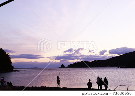 First sunrise, sea, sandy beach 73630956