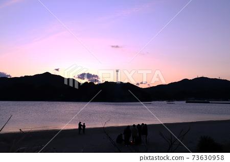 First sunrise, sea, sandy beach 73630958