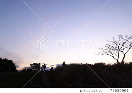 First sunrise, sea, sandy beach 73630961
