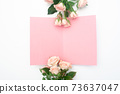 wedding or birthday mock up scene. Blank open sheet of paper with place for text for greeting card. Bouquet of pink roses on white background. Flat lay, top view 73637047