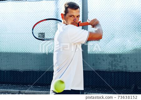 Proffesional tennis player beats off a ball during match 73638152