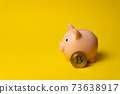 Pink pig as money box on yellow background with BTC coin 73638917