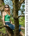 Girl on tree 73641986