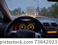 Driving in the evening 73642023