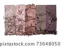 Set of eyeshadow sample isolated on white background. Crushed brown metallic eyeshadow.  73648050