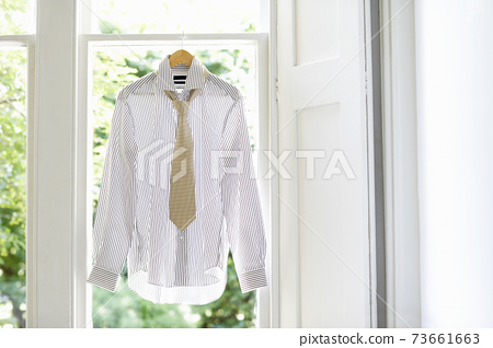 Shirt And Tie On Hanger At Home 73661663