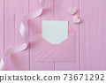 Wedding or birthday mock up scene. Blank open envelope with place for text for greeting card copyspace. Valentines card with two hearts on pink background. Flat lay, top view 73671292