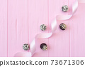Chocolate handmade candies on pink wooden table with festive ribbon with place for your text copyspace 73671306
