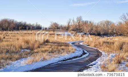 bike trail in late fall or winter scenery 73673815