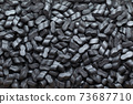 Black foam Peanuts Packaging Filler Cushioning  Polystyrene Material texture  shipping Background 73687710